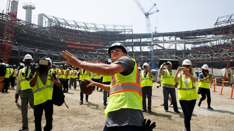<p>               FILE - In this June 14, 2018, file photo, Los Angeles Rams quarterback Jared Goff throws the ball to construction workers while visiting the team's new NFL football stadium, in Inglewood, Calif. Although the palatial Inglewood NFL stadium is still nearly two years from completion, the Los Angeles Rams and Los Angeles Chargers are ready to fill it up. The Rams will begin season ticket sales in two weeks for more than 50,000 seats in the under-construction stadium at Hollywood Park, COO Kevin Demoff announced Thursday, Sept. 6, 2018. (AP Photo/Jae C. Hong, File)             </p>