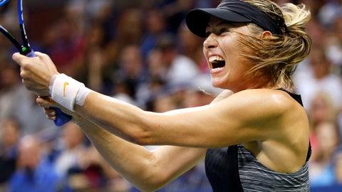 <p>               Maria Sharapova, of Russia, returns a shot to Carla Suarez Navarro, of Spain, during the fourth round of the U.S. Open tennis tournament, Monday, Sept. 3, 2018, in New York. (AP Photo/Jason DeCrow)             </p>
