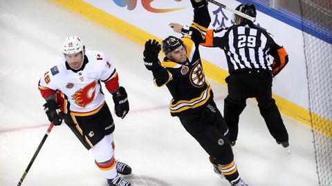 <p>               Jake DeBrusk (74) of the Boston Bruins, right, celebrates next to James Neal (18) of the Calgary Flames after scoring a goal during the first period of their 2018 NHL China Games hockey game in Beijing, China, Wednesday, Sept. 19, 2018. (AP Photo/Mark Schiefelbein)             </p>