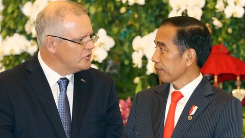 <p>               Australian Prime Minister Scott Morrison, left, talks to Indonesian President Joko Widodo, right, during a signing ceremony at the presidential palace in Bogor, West Java, Indonesia, Friday, Aug. 31, 2018. (AP Photo/Achmad Ibrahim)             </p>