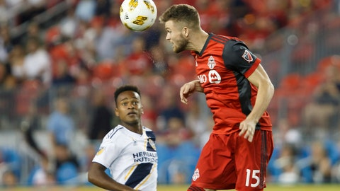 <p>               Toronto FC forward Eriq Zavaleta (15) hits a header during the first half of an MLS soccer game against the LA Galaxy, Saturday, Sept. 15, 2018 in Toronto. (Cole Burston/Canadian Press via AP)             </p>