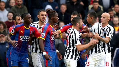 <p>               Crystal Palace's Wilfried Zaha, centre, is held back by teammates as he clashes with Newcastle United's Kenedy, during the English Premier League soccer match between Crystal Palace and Newcastle United, at Selhurst Park, in London, Saturday, Sept. 22, 2018.(Jonathan Brady/PA via AP)             </p>