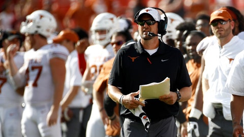 <p>               Texas head coach Tom Herman walks on the sideline in the second half of an NCAA college football game against Maryland, Saturday, Sept. 1, 2018, in Landover, Md. (AP Photo/Patrick Semansky)             </p>