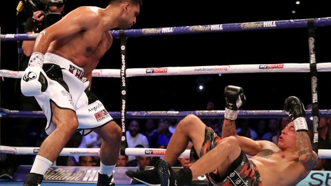 <p>               Amir Khan, left, knocks down Samuel Vargas in action during their Welterweight contest at Arena Birmingham, in Birmingham, England, Saturday Sept. 8, 2018. (Nick Potts/PA via AP)             </p>
