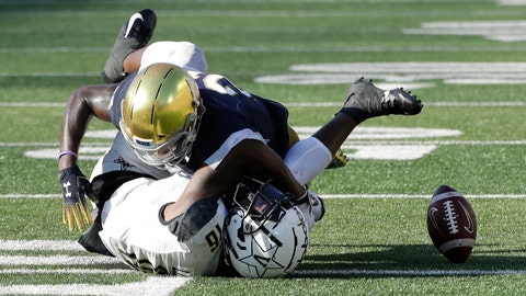 <p>               Notre Dame safety Jalen Elliott, top, tackles as Vanderbilt wide receiver Kalija Lipscomb misses the ball during the second half of an NCAA college football game in South Bend, Ind., Saturday, Sept. 15, 2018. Notre Dame won 22-17. (AP Photo/Nam Y. Huh)             </p>