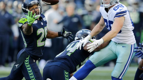 <p>               Seattle Seahawks free safety Earl Thomas, left, reaches for a pass he intercepted that was intended for Dallas Cowboys tight end Blake Jarwin, right, as Seahawks' Bobby Wagner, center, looks on during the second half of an NFL football game, Sunday, Sept. 23, 2018, in Seattle. The pick was Thomas' second of the game. (AP Photo/John Froschauer)             </p>