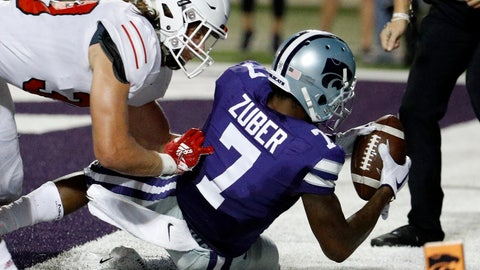 <p>               Kansas State wide receiver Isaiah Zuber (7) is tackled in the end zone by South Dakota linebacker Jack Cochrane (39) after scoring a touchdown during the second half of an NCAA college football game Saturday, Sept. 1, 2018, in Manhattan, Kan. Kansas State won 27-24. (AP Photo/Charlie Riedel)             </p>