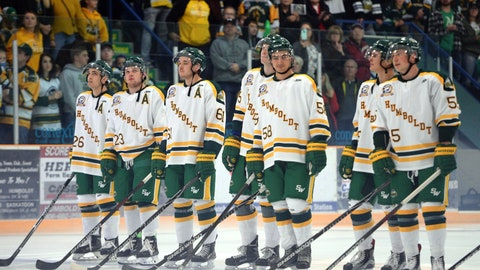 <p>               Returning Humboldt Broncos players Brayden Camrud (26) and Derek Patter (23), far left, take part in the pregame ceremony along with other teammate before playing the Nipawin Hawks in the SJHL hockey season home opener in Humboldt, Saskatchewan, Wednesday, Sept. 12, 2018. The Humboldt Broncos are playing their first game since a bus crash claimed 16 lives in April. (Jonathan Hayward/The Canadian Press via AP)             </p>