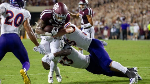 <p>               Texas A&M running back Trayveon Williams (5) fights off Northwestern State defenders on his way to a touchdown during the first half of NCAA college football game Thursday, Aug. 30, 2018, in College Station, Texas. (AP Photo/Sam Craft)             </p>