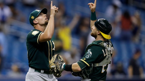 <p>               Oakland Athletics pitcher Blake Treinen, left, celebrates with catcher Jonathan Lucroy after defeating the Tampa Bay Rays 2-1 during a baseball game Friday, Sept. 14, 2018, in St. Petersburg, Fla. (AP Photo/Chris O'Meara)             </p>