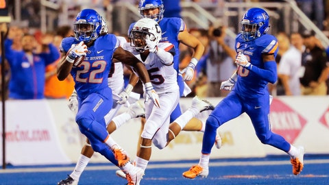 <p>               Boise State running back Alexander Mattison (22) rushes past a Connecticut defender in the first half of an NCAA college football game, Saturday, Sept. 8, 2018, in Boise, Idaho. (AP Photo/Steve Conner)             </p>