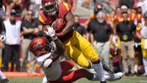 <p>               Southern California running back Stephen Carr, top, is tackled by UNLV defensive back Jericho Flowers during the first half of an NCAA college football game Saturday, Sept. 1, 2018, in Los Angeles. (AP Photo/Mark J. Terrill)             </p>