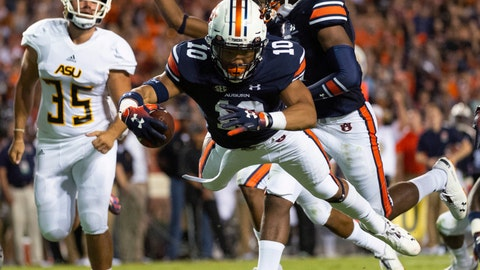 <p>               Auburn running back Devan Barrett (10) dives into the end zone for touchdown after a blocked punt by Alabama State during the first half of an NCAA college football game, Saturday, Sept. 8, 2018, in Auburn, Ala. (AP Photo/Vasha Hunt)             </p>