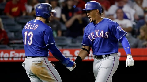 <p>               Texas Rangers' Ronald Guzman, right, celebrates his two-run home run with teammate Joey Gallo (13) during the second inning of a baseball game against the Los Angeles Angels Monday, Sept. 10, 2018, in Anaheim, Calif. (AP Photo/Marcio Jose Sanchez)             </p>