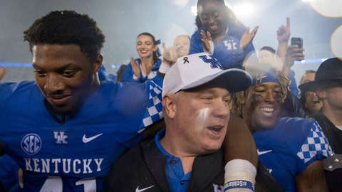 <p>               Kentucky coach Mark Stoops celebrates with players and fans on the field after the team's 28-7 win over Mississippi State during an NCAA college football game in Lexington, Ky., Saturday, Sept. 22, 2018. (AP Photo/Bryan Woolston)             </p>
