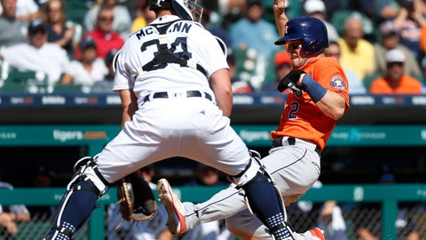 <p>               Houston Astros' Alex Bregman (2) scores at home plate as Detroit Tigers catcher James McCann (34) waits for the throw in the fifth inning of a baseball game in Detroit, Wednesday, Sept. 12, 2018. (AP Photo/Paul Sancya)             </p>