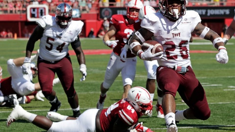 <p>               Troy running back B.J. Smith (26) runs into the end zone past Nebraska defensive lineman Khalil Davis (94) during the first half of an NCAA college football game in Lincoln, Neb., Saturday, Sept. 15, 2018. (AP Photo/Nati Harnik)             </p>