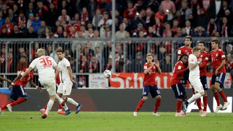 <p>               Augsburg's Martin Hinteregger, left, takes a free kick during the German Bundesliga soccer match between FC Bayern Munich and FC Augsburg in Munich, Germany, Tuesday, Sept. 25, 2018. (AP Photo/Matthias Schrader)             </p>