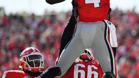 <p>               Georgia offensive lineman Solomon Kindley (66) lifts Georgia wide receiver Mecole Hardman (4) after Hardman's touchdown during the first half of an NCAA college football game, Saturday, Sept. 1, 2018, in Athens, Ga. (AP Photo/Mike Stewart)             </p>