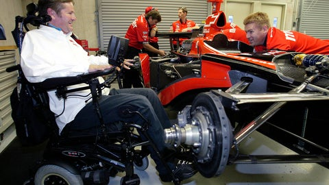 <p>               FILE - In this Friday, May 20, 2005 file photo, Indy Racing League car owner Sam Schmidt, left, talks with crew member Mike Sobeleski as he works on the car in the garage area at the Indianapolis Motor Speedway.  Sam Schmidt was left quadriplegic from a racing accident and the team he later created has suffered a series of tragedies and setbacks.  (AP Photo/Tom Strattman, File)             </p>