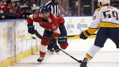 <p>               Florida Panthers' Jared McCann, left, keeps his eye on the puck as he maneuvers around a Nashville Predators defender during the first period of an NHL hockey game, Monday, Sept. 17, 2018. (Carl Juste/Miami Herald via AP)             </p>