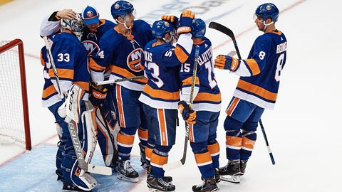 <p>               New York Islanders players celebrate their victory after a preseason NHL hockey game against the Philadelphia Flyers in New York, Sunday, Sept. 16, 2018. (AP Photo/Andres Kudacki)             </p>