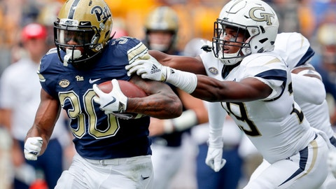 <p>               Pittsburgh running back Qadree Ollison (30) breaks fee from Georgia Tech defensive back Tariq Carpenter on his way to a touchdown run in the first quarter of an NCAA football game, Saturday, Sept. 15, 2018, in Pittsburgh. (AP Photo/Keith Srakocic)             </p>