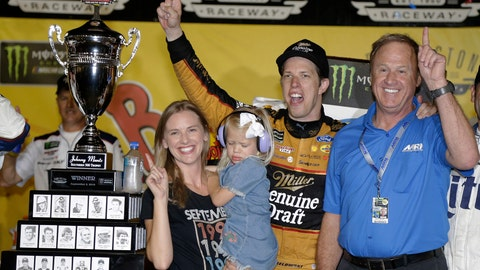 <p>               Brad Keselowski celebrates with his wife, Paige; daughter, Scarlett; and former Team Penske driver Rusty Wallace, right, in Victory Lane after winning the NASCAR Cup Series auto race at Darlington Raceway, Sunday, Sept. 2, 2018, in Darlington, S.C. (AP Photo/Terry Renna)             </p>