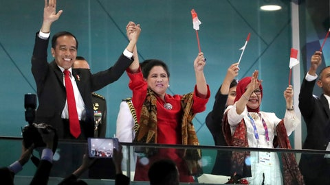 "<p>               FILE - In this Aug. 18, 2018, file photo, Indonesian President Joko Widodo, left, and his wife Iriana wave during the opening ceremony for the 18th Asian Games in the Gelora Bung Karno Stadium, Jakarta, Indonesia. Indonesia's hosting of the Asian Games and a record haul of gold medals has swelled national pride, providing a boost to the re-election campaign of President Joko ""Jokowi"" Widodo. (AP Photo/Dita Alangakara, File)             </p>"