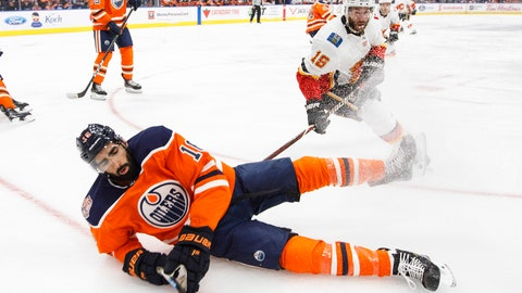 <p>               Calgary Flames ' Anthony Peluso (16) trips up Edmonton Oilers' Jujhar Khaira (16) during the first period of an NHL preseason hockey game in Edmonton on Saturday, Sept. 29, 2018. (Jason Franson/The Canadian Press via AP)             </p>