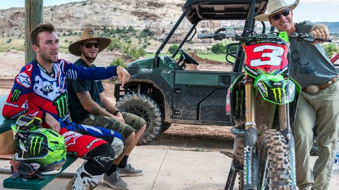 <p>               In a photo provided by Skyler Bishop Photography Eli Tomac, left, Tanner McCullers, center, and John Tomac discuss a recent motocross riding session at Tomac Ranch in Cortez, Colo., July 20, 2017. Tomac is taking a unique path to motocross stardom from the southwestern corner of Colorado. He has his own track in Cortez and is trained by his father, a retired professional mountain bike racer. Tomas has staked a claim to becoming motocross' next big star following the retirements of Ryan Villopoto and Ryan Dungey. (Skyler Bishop Photography via AP)             </p>