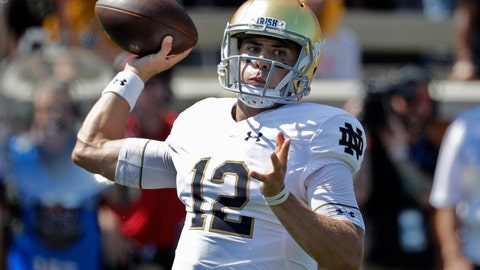<p>               Notre Dame's Ian Book (12) looks to pass against Wake Forest in the first half of an NCAA college football game in Winston-Salem, N.C., Saturday, Sept. 22, 2018. (AP Photo/Chuck Burton)             </p>