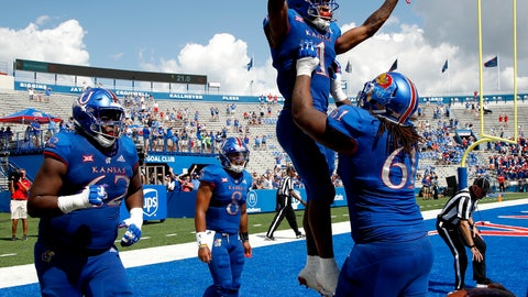 <p>               Kansas running back Pooka Williams Jr. (1) celebrates with offensive lineman Malik Clark (61) after scoring a touchdown during the second half of an NCAA college football game against Rutgers, Saturday, Sept. 15, 2018, in Lawrence, Kan. Kansas won 55-14. (AP Photo/Charlie Riedel)             </p>