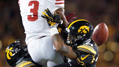 <p>               Iowa defensive backs Matt Hankins, left, and Amani Hooker, right, dislodge the ball from Wisconsin wide receiver Kendric Pryor, center, resulting in an incomplete pass during the first half of an NCAA college football game Saturday, Sept. 22, 2018, in Iowa City. (AP Photo/Matthew Putney)             </p>