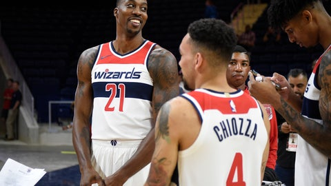 <p>               Washington Wizards' Dwight Howard stands near to Chris Chiozza (4) during an NBA basketball media day, Monday, Sept. 24, 2018, in Washington. (AP Photo/Nick Wass)             </p>