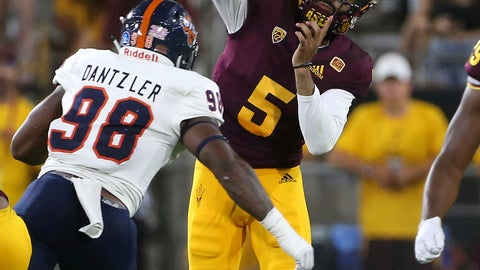 <p>               Arizona State quarterback Manny Wilkins (5) throws a pass as he is pressured by UTSA defensive end Lorenzo Dantzler during the second half of an NCAA college football game, Saturday, Sept. 1, 2018, in Tempe, Ariz. (AP Photo/Ralph Freso)             </p>