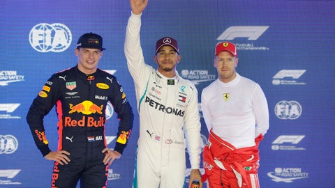 <p>               From left, Red Bull driver Max Verstappen of the Netherlands, Mercedes driver Lewis Hamilton of Britain, Ferrari driver Sebastian Vettel of Germany poses after taking pole position during qualifying at the Marina Bay City Circuit ahead of the Singapore Formula One Grand Prix in Singapore, Saturday, Sept. 15, 2018. (AP Photo/Vincent Thian)             </p>