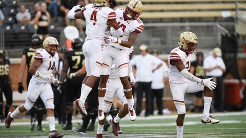 <p>               Boston College's Hamp Cheevers (4) and Brandon Sebastian (10) celebrate Cheevers' interception during the first half of an NCAA college football game against Wake Forest, Thursday, Sept. 13, 2018, in Winston-Salem, N.C. (AP Photo/Woody Marshall)             </p>