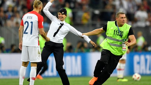 <p>               FILE - In this Sunday, July 15, 2018 file photo, stewards pull a woman off the pitch after she stormed onto the field and interrupted the final match between France and Croatia at the 2018 soccer World Cup in the Luzhniki Stadium in Moscow, Russia. The chief organizer of Russia's World Cup says police stopped 170 people from invading the pitch during games before four members of the Pussy Riot protest group eventually stormed the final dressed as police officers. Organizing committee CEO Alexei Sorokin has downplayed security problems despite the pitch invasion that happened in the final between France and Croatia on July 15. (AP Photo/Martin Meissner, File)             </p>