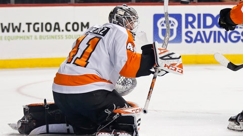 <p>               Philadelphia Flyers goaltender Anthony Stolarz deflects the puck with his stick on a shot by the New York Islanders in the second period of a preseason NHL hockey game on Tuesday, Sept. 18, 2018, in New York. (AP Photo/Adam Hunger)             </p>