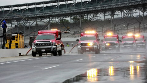 <p>               Track driers work to dry the pit lane before the NASCAR Brickyard 400 auto race at Indianapolis Motor Speedway, in Indianapolis Sunday, Sept. 9, 2018. (AP Photo/R Brent Smith)             </p>