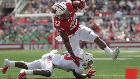 <p>               Wisconsin's Jonathan Taylor runs over New Mexico's Michael Sewell Jr. during the second half of an NCAA college football game Saturday, Sept. 8, 2018, in Madison, Wis. Wisconsin won 45-14. (AP Photo/Morry Gash)             </p>