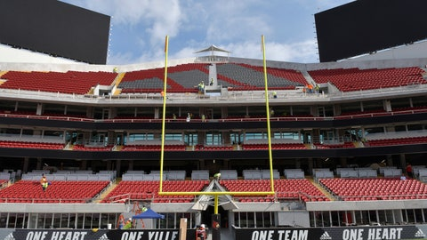 <p>               Workers continue to put the final touches on the expansion of Cardinal Stadium, Wednesday, Sept. 5, 2018, in Louisville, Ky. The expansion adds about 6,000 seats to Cardinal Stadium, including expensive and exclusive field-level suites, premium boxes and club seats, among other amenities. Louisville plays Indiana State this week. (AP Photo/Timothy D. Easley)             </p>