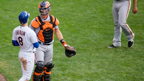 <p>               Milwaukee Brewers' Ryan Braun, left, reacts to San Francisco Giants' Madison Bumgarner, right, after being hit by a pitch during the sixth inning of an baseball game Sunday, Sept. 9, 2018, in Milwaukee. (AP Photo/Darren Hauck)             </p>