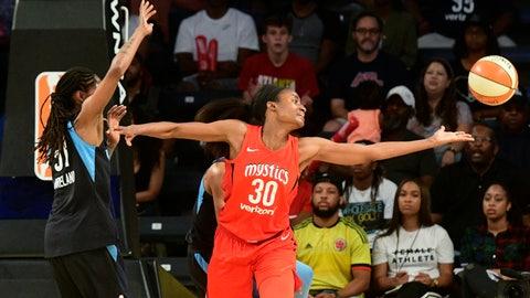 <p>               Washington Mystics forward LaToya Sanders (30) fends off Atlanta Dream forward Jessica Breland as she reaches for a rebound during the first half of Game 5 of a WNBA basketball playoffs semifinal Monday, Sept. 4, 2018, in Atlanta. (AP Photo/John Amis)             </p>