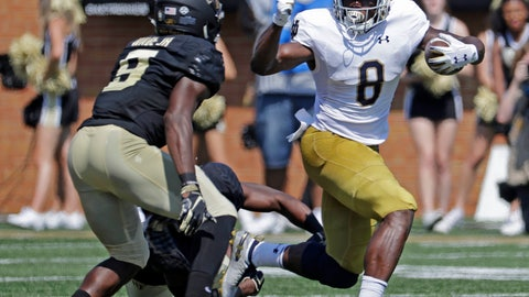 <p>               Notre Dame's Jafar Armstrong (8) runs as Wake Forest's Chuck Wade Jr. (9) defends in the first half of an NCAA college football game in Winston-Salem, N.C., Saturday, Sept. 22, 2018. (AP Photo/Chuck Burton)             </p>