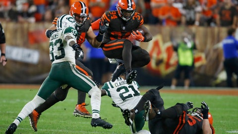 <p>               Cleveland Browns running back Carlos Hyde (34) jumps over defenders during the second half of an NFL football game against the New York Jets, Thursday, Sept. 20, 2018, in Cleveland. (AP Photo/Ron Schwane)             </p>