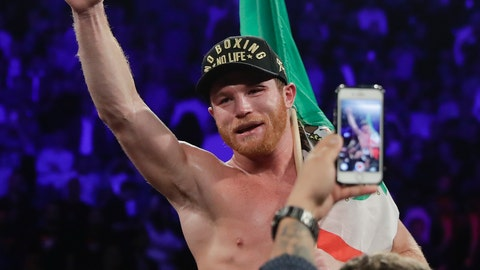 <p>               Canelo Alvarez celebrates after defeating Gennady Golovkin by majority decision in a middleweight title boxing match, Saturday, Sept. 15, 2018, in Las Vegas. (AP Photo/Isaac Brekken)             </p>