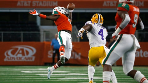 <p>               Miami wide receiver Jeff Thomas, left, makes a one-handed catch for a first down in front of LSU linebacker K'Lavon Chaisson, second from right, during the first half of an NCAA college football game Sunday, Sept. 2, 2018, in Arlington, Texas. (AP Photo/Ron Jenkins)             </p>
