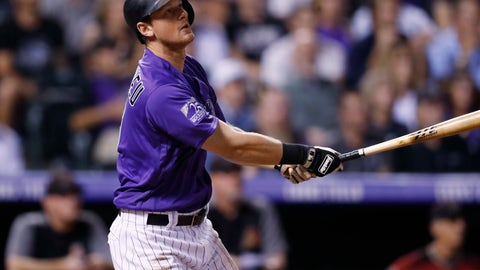 <p>               Colorado Rockies' DJ LeMahieu follows the flight of his two-run, walkoff home run off Arizona Diamondbacks relief pitcher Yoshihisa Hirano in the ninth inning of a baseball game Wednesday, Sept. 12, 2018, in Denver. The Rockies won 5-4. (AP Photo/David Zalubowski)             </p>